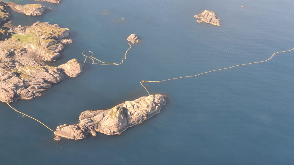An aerial view of the large net and the smaller pen
